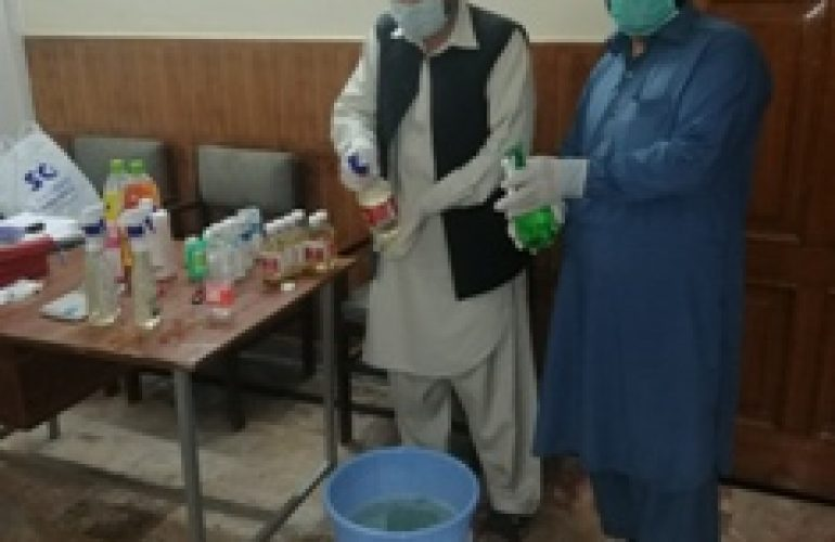 Facing shortages, the field staff in Peshawar prepares antiseptic solution to be used in office, Basic Health Units and Vehicles.